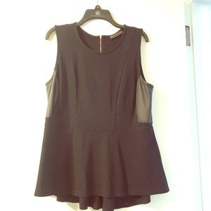 Black and leather sided peplum top